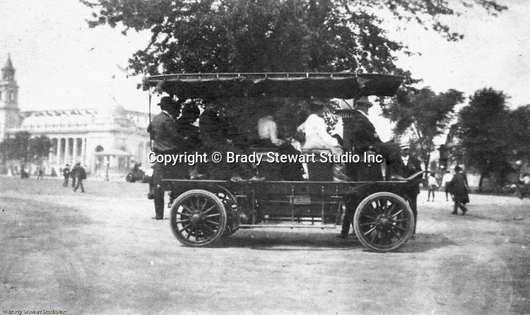 Client: St Louis Exhibition<br /> Product: Transport carrier<br /> Manufacturer: St Louis Car Company<br /> <br /> St Louis MO:  A view of one of the many &quot;new&quot; buses used to transport the millions of visitors around the exposition.  The palace of Varied Industries is in the background