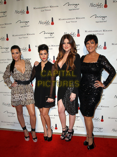 Kim Kardashian, Kourtney Kardashian, Khloe Kardashian Odom, Kris Jenner.The Kardashian Family celebrates the Grand Opening of Kardashian Khaos at The Mirage Hotel and Casino, Las Vegas, Nevada, USA,.15th December 2011..full length sisters siblings daughters mom mum mother leopard print dress black pregnant sequined sequin hand on hip .CAP/ADM/MJT.© MJT/AdMedia/Capital Pictures.