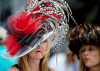 BALTIMORE, MD - MAY 20: Two women wearing festive hats walk through the grandstand on Preakness Stakes Day at Pimlico Race Course on May 20, 2017 in Baltimore, Maryland.(Photo by Scott Serio/Eclipse Sportswire/Getty Images)