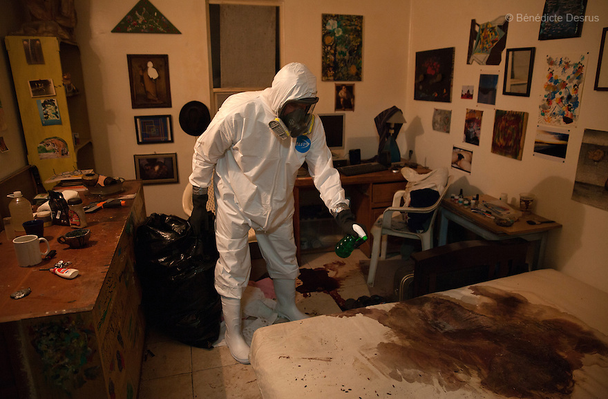 """Donovan carries out a forensic cleaning in the middle-class neighborhood of Colonia del Valle, Mexico City, Mexico on April 26th, 2016. The 65-year-old deceased --who was HIV positive-- worked as a painter, and lived on the roof of the private psychologist's clinic where he had been receiving treatment for depression. His body was discovered in the practice three days after he committed suicide, when hispsychologist was alerted by the odor and the presence of flies. Donovan Tavera, 43, is the director of """"Limpieza Forense México"""", the country's first and so far the only government-accredited forensic cleaning company. Since 2000, Tavera, a self-taught forensic technician, and his family have offered services to clean up homicides, unattended death, suicides, the homes of compulsive hoarders and houses destroyed by fire or flooding. Despite rising violence that has left 70,000 people dead and 23,000 disappeared since 2006, Mexico has only one certified forensic cleaner. As a consequence, the biological hazards associated with crime scenes are going unchecked all around the country. Photo by Bénédicte Desrus"""
