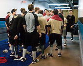 Russ DeRosa (BC - Strength Coach) addresses the Eagles after they finish stretching. - The Boston College Eagles defeated the University of Minnesota Duluth Bulldogs 4-0 to win the NCAA Northeast Regional on Sunday, March 25, 2012, at the DCU Center in Worcester, Massachusetts.