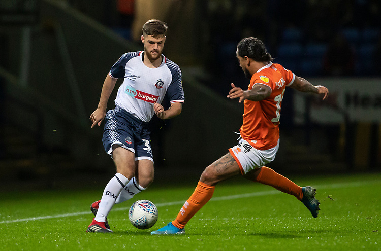 Bolton Wanderers' Sonny Graham competing with Blackpool's Sean Scannell (right) <br /> <br /> Photographer Andrew Kearns/CameraSport<br /> <br /> The EFL Sky Bet League One - Bolton Wanderers v Blackpool - Monday 7th October 2019 - University of Bolton Stadium - Bolton<br /> <br /> World Copyright © 2019 CameraSport. All rights reserved. 43 Linden Ave. Countesthorpe. Leicester. England. LE8 5PG - Tel: +44 (0) 116 277 4147 - admin@camerasport.com - www.camerasport.com