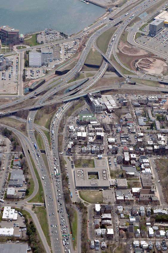 """Pearl Harbor Memorial """"Q"""" Bridge, East Bound Approaches just west of Bridge. I95 I91 Route 34 Interchange Aerial Photograph, view Southwest, I-91 left vertical. Showing surface Streets: Chapel, Hamilton, Water, East & Wooster and Long Wharf Drive on 17 April 2009."""