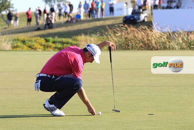 Ross Fisher (ENG) on the 18th green during Saturday's Round 3 of the Portugal Masters at the Oceanico Victoria Golf Course, Vilamoura, Portugal 13th October 2012 (Photo Eoin Clarke/www.golffile.ie)