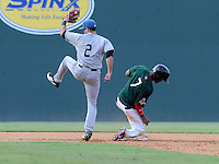 Infielder Taylor Featherston (2) of the Asheville Tourists takes the throw but is too late to make the out on Jose Garcia (7) of the Greenville Drive, who steals second in a game on Sunday, August 26, 2012, at Fluor Field at the West End in Greenville, South Carolina. Greenville won, 5-4. (Tom Priddy/Four Seam Images)