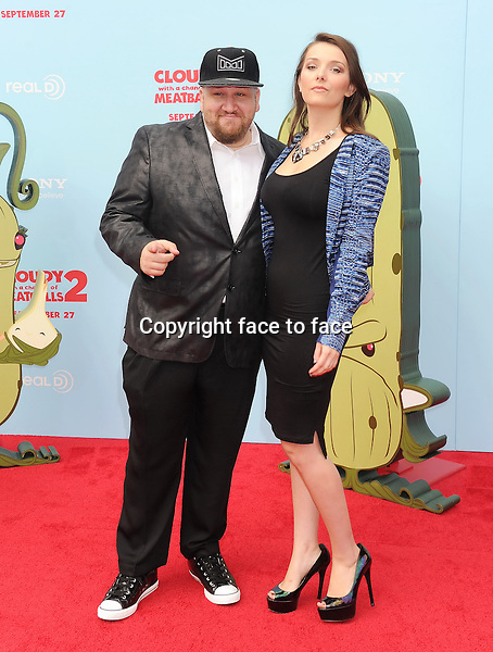 WESTWOOD, CA- SEPTEMBER 21: Actor Stephen Kramer Glickman (L) and guest arrive at the Los Angeles premiere of 'Cloudy With A Chance Of Meatballs 2' at the Regency Village Theatre on September 21, 2013 in Westwood, California.(Stephen Kramer Glickman)<br />