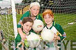 ON THE BALL: Catriona McCarthy, Niamh O'Sullivan and Erin O'Connor enjoying the Kerry GAA/VHI Cul Camp in Currow on Friday last...
