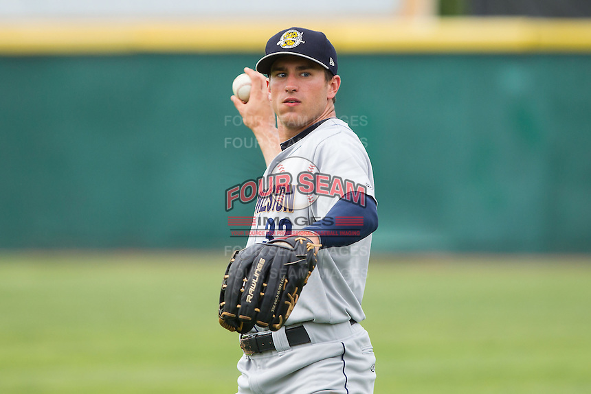 Brandon Thomas (32) of the Charleston RiverDogs warms up in the outfield prior to the game against the Hickory Crawdads at L.P. Frans Stadium on May 25, 2014 in Hickory, North Carolina.  The RiverDogs defeated the Crawdads 17-10.  (Brian Westerholt/Four Seam Images)