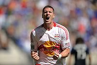 Kenny Cooper (33) of the New York Red Bulls celebrates scoring. The New York Red Bulls defeated the Philadelphia Union 2-0 during a Major League Soccer (MLS) match at Red Bull Arena in Harrison, NJ, on July 21, 2012.