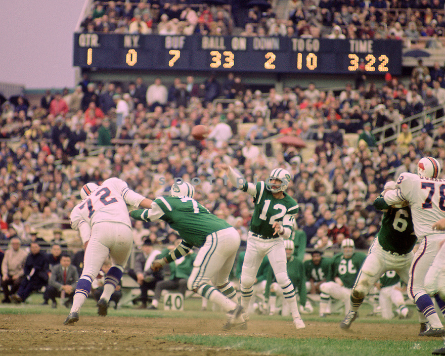 New York Jets Joe Namath(12) during a game against the Buffalo Bill on November 3, 1968 at Shea Stadium in Flushing, New York.  The New York Jets beat the Buffalo Bills 25-21.  Joe Namath played for 13 years for 2 different teams, was a 5-time Pro Bowler and was inducted to the Pro Football Hall of Fame in 1985,(SportPics)