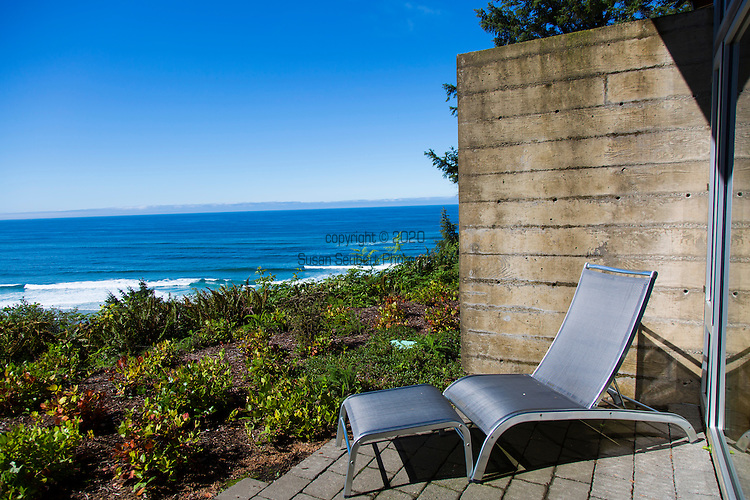 """Neahkahnie Beach in Manzanita, Oregon, a small beach town located in Tillamook County on the Northern Oregon coast.  Manzanita means """"little apple"""" in Spanish.  Neahkahnie Mountain is located at the north end of the 7 mile long beach.  The Awtrey house, designed by architect James Culter"""