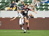 CARSON, CA - March 18,2012: LA Galaxy midfielder Landon Donovan (10) and DC United defender Chris Korb (22) during the LA Galaxy vs DC United match at the Home Depot Center in Carson, California. Final score LA Galaxy 3, DC United 1.