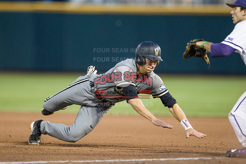 Vanderbilt Commodores outfielder Bryan Reynolds (20) dives back to first base during the NCAA College baseball World Series against the TCU Horned Frogs on June 16, 2015 at TD Ameritrade Park in Omaha, Nebraska. Vanderbilt defeated TCU 1-0. (Andrew Woolley/Four Seam Images)