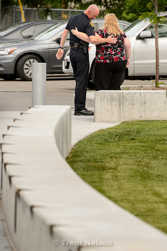 Trent Nelson  |  The Salt Lake Tribune<br /> Former Salt Lake City Police Chief Chris Burbank embraces an unidentified woman after speaking to reporters about his departure in front of the Public Safety Building in Salt Lake City Thursday June 11, 2015.