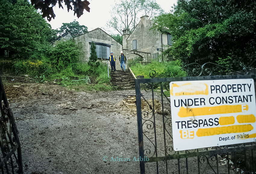 Whitecroft woods. Private Security  guard a building from being squatted,  Solsbury Hill road protest.