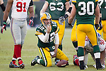 Green Bay Packers quarterback Aaron Rodgers (12) signals a first down during an NFL divisional playoff football game against the New York Giants on January 15, 2012 in Green Bay, Wisconsin. The Giants won 37-20. (AP Photo/David Stluka)