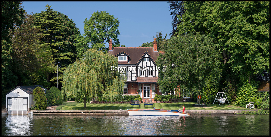 BNPS.co.uk (01202 558833)<br /> Pic: Savills/BNPS<br /> <br /> Perfect for 'Messing about on the water' <br /> <br /> Idyllic 'Toad Hall' on the River Thames near Cookham is in the heart of the Wind in the Willows landscape created by author Kenneth Grahame, and has floated on to the market for a cool £3.45m.<br /> <br /> The aptly-named Hall overlooks the picturesque Cookham Reach of the River Thames where Grahame grew up, and boasts 130ft of private mooring, a boathouse, and even its own willow tree in the garden.<br /> <br /> The classic country house is an idyllic property for anyone looking for the quintessentially British boating lifestyle of Ratty, Mole and Mr Toad that Kenneth Grahame brought to life from an Edwardian England now long gone.<br /> <br /> It is now on the market with Savills.