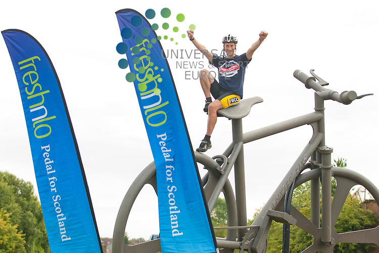 Pictured: Graeme sits on top of a giant bicycle. World champion cyclist Graeme Obree today kicked off the four week countdown to freshnlo Pedal For Scotland 2012 at Bankies Bike, Clydebank. 9th August 2012. Picture: Jonathan Faulds / Universal News And Sport (Europe)