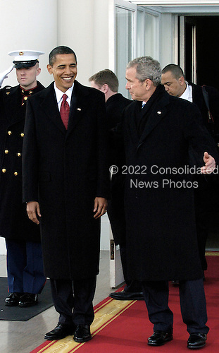 Washington, DC - January 20, 2009 -- United States President George W. Bush and President-Elect Barack Obama depart the White House through the North Portico, as they head for the swearing-in ceremony on Tuesday, January 20, 2009, in Washington, DC. .Credit: Leslie Kossoff - Pool via CNP