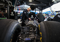 Feb 10, 2019; Pomona, CA, USA; Crew member for NHRA top fuel driver Antron Brown during the Winternationals at Auto Club Raceway at Pomona. Mandatory Credit: Mark J. Rebilas-USA TODAY Sports