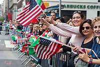 Iranian-Americans and their supporters at the 23rd annual Persian Parade on Madison Ave. in New York on Sunday, April 30, 2017. The parade celebrates Nowruz, New Year in the Farsi language. The holiday symbolizes the purification of the soul and dates back to the pre-Islamic religion of Zoroastrianism. (© Richard B. Levine)