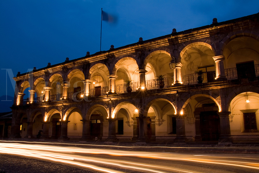 Night photo of famous building Arco de santa Catalina with twilight and streaks of traffic  in the tourism town of Antigua Guatemal