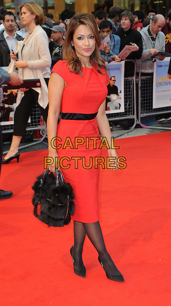Tasmin Lucia Khan.World Premiere of 'Larry Crowne' at the Vue Cinema, Westfield Shopping Centre, London, England, UK,.June 6th 2011..full length red dress black fur bag tights shoes .CAP/WIZ.© Wizard/Capital Pictures.