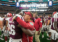 Hawgs Illustrated/Ben Goff<br /> Chad Morris, Arkansas head coach, greets Charles Strong, Jr., Texas A&M running back, after the game Saturday, Sept. 29, 2018, during the Southwest Classic at AT&T Stadium in Arlington, Texas.