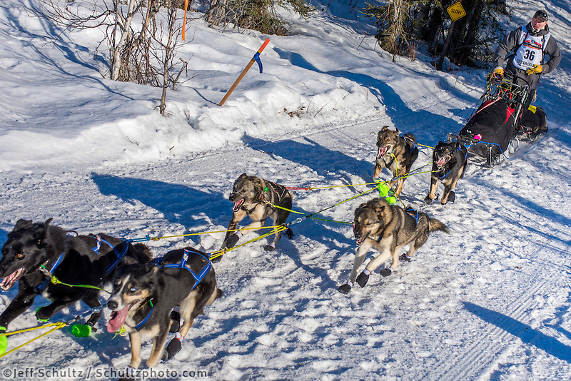 Mats Pettersson and team run down the trail on Long Lake shortly after leaving the re-start in Willow, Alaska on Sunday, March 6th during the 2016 Iditarod race. Photo by Joshua Borough/SchultzPhoto.com