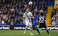 Kevin Wimmer of Tottenham Hotspur flicks the ball over Afran Ismayilov of Qarabag FK during the UEFA Europa League match between Tottenham Hotspur and Qarabag FK at White Hart Lane, London, England on 17 September 2015. Photo by Andy Rowland.