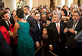 Washington, DC - December 15, 2009 -- United States First Lady Michelle Obama greets guests in the Grand Foyer of the White House during a holiday party, Tuesday, December 15, 2009. .Mandatory Credit: Lawrence Jackson - White House via CNP