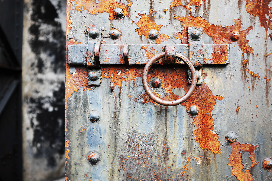 Rusty steel latch on concrete bunker tunnel door, Artillery Hill, Fort Worden State Park, Port Townsend, Washington, USA