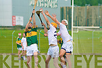 Kerry's Colm Harty and Kildare's l-r: Paul Kennedy and Conor Kenny.