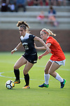 Estelle Laurier (10) of the Wake Forest Demon Deacons keeps the ball away from Shannon Horgan (7) of the Clemson Tigers during first half action at Riggs Field on October 22 2017 in Clemson, South Carolina.  The Tigers defeated the Demon Deacons 2-1. (Brian Westerholt/Sports On Film)