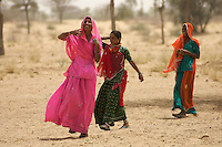 Women in the Thar Desert near Manvar on the way to Jaisalmer, Rajasthan India