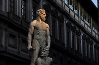 Detail of statue of Hercules and Cacus, 1525-34, by Bandinelli, Piazza della Signoria, Florence, Tuscany, Italy, pictured on June 9, 2007, in the afternoon with the Uffizi Gallery in the background. The statue of Hercules and Cacus by Baccio Bandinelli (1525-34) was originally commissioned from Michelangelo as a pair to the David statue, and the re-assignment to Bandinelli was highly controversial; but the Medicis were satisfied and rewarded Bandinelli richly. The sculpture represents physical strength in contrast to David's spiritual strength. Florence, capital of Tuscany, is world famous for its Renaissance art and architecture. Its historical centre was declared a UNESCO World Heritage Site in 1982. Picture by Manuel Cohen.