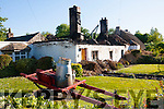 Disaster<br /> -----------<br /> The gutted remains of the early 1800's thatched cottage in the picturesque tourist town of Adare pictured on Sunday afternoon 24hrs after it caught fire.