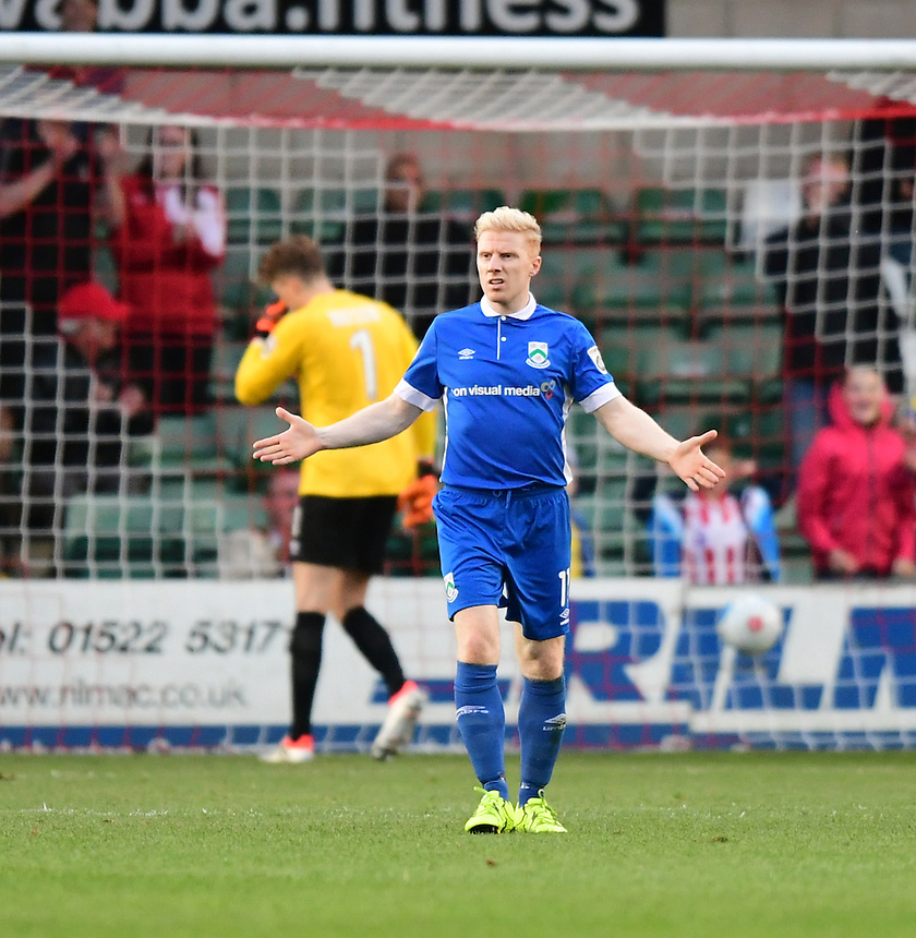 North Ferriby United's Simon Russell reacts after Lincoln City's fourth goal<br /> <br /> Photographer Chris Vaughan/CameraSport<br /> <br /> Football - Vanarama National League - Lincoln City v North Ferriby United - Tuesday 9th August 2016 - Sincil Bank - Lincoln<br /> <br /> &copy; CameraSport - 43 Linden Ave. Countesthorpe. Leicester. England. LE8 5PG - Tel: +44 (0) 116 277 4147 - admin@camerasport.com - www.camerasport.com