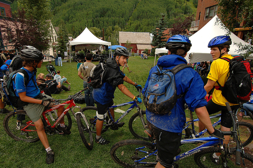 From the left, John Yeager, 15, of Jackson Hole, WY, Rob Wax, 16 from New York City, Justin Katchis, 16, of New York City, and Phil Koonce, 15 of Charlotte, NC take in some free music during Tellurides Jazz Festival, after a mountain bike ride. © Michael Brands. 970-379-1885.