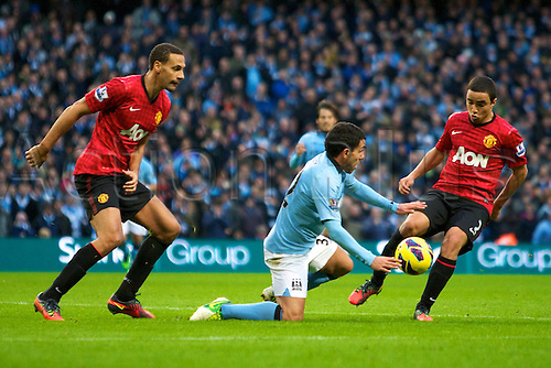 09.12.2012 Manchester, England. Manchester United's Brazilian defender Rafael, Manchester City's Spanish midfielder David Silva and Manchester United's English defender Rio Ferdinand in action during the Premier League game between Manchester City and Manchester United from the Etihad Stadium. Manchester United scored a late winner to take the game 2-3.