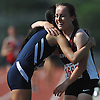 Samantha Law, Great Neck North sophomore, left, gets a congratulatory hug from competitor Carissa Kahn of Mepham after she won the girls 1,500 meter run in the Nassau County AA track and field championships at Glen Cove High School on Thursday, May 26, 2016. Law posted a time of 5:02.86 while Kahn finished in second at 5:11.35.