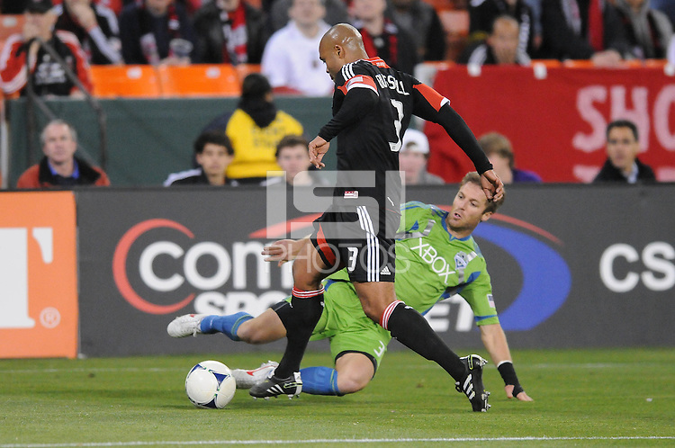 D.C. United defender Robbie Russell (3) goes against Seattle Sounders midfielder Brad Evans (3) D.C. United tied the Seattle Sounders, 0-0 at RFK Stadium, Saturday April 7, 2012.