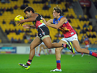 James Gwilt juggles the ball during the Australian Rules Football ANZAC Day match between St Kilda Saints and Brisbane Lions at Westpac Stadium, Wellington, New Zealand on Friday, 25 April 2014. Photo: Dave Lintott / lintottphoto.co.nz