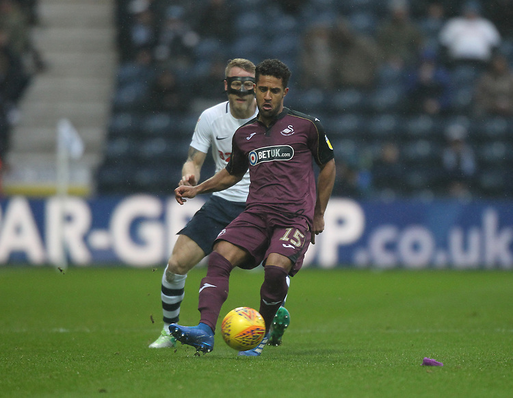 Preston North End's Tom Clarke battles with  Swansea City's Wayne Routledge<br /> <br /> Photographer Mick Walker/CameraSport<br /> <br /> The EFL Sky Bet Championship - Preston North End v Swansea City - Saturday 12th January 2019 - Deepdale Stadium - Preston<br /> <br /> World Copyright &copy; 2019 CameraSport. All rights reserved. 43 Linden Ave. Countesthorpe. Leicester. England. LE8 5PG - Tel: +44 (0) 116 277 4147 - admin@camerasport.com - www.camerasport.com