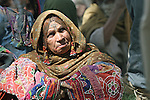 A woman from the nomadic Kuchi tribe waits outside the district center of Shar-e-Safa in Zabul province, Afghanistan. U.S. troops provided medical care, and Afghan police distributed winter clothes, food staples and other relief items to about 200 people before they ran out of supplies.  Aug. 25, 2008. DREW BROWN/STARS AND STRIPES
