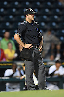Home plate umpire Joe George during a game between the Jupiter Hammerheads and Bradenton Marauders on April 17, 2014 at McKechnie Field in Bradenton, Florida.  Bradenton defeated Jupiter 2-1.  (Mike Janes/Four Seam Images)