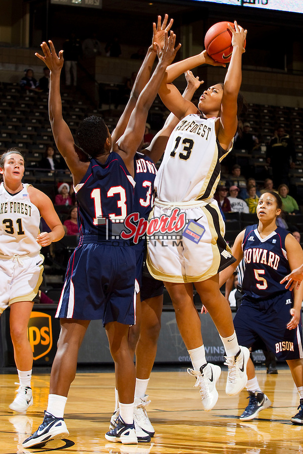 Mykala Walker #13 of the Wake Forest Demon Deacons shoots over Nicole Deterville #32 and Saadia Doyle #13 of the Howard Bison at the LJVM Coliseum on December 18, 2011 in Winston-Salem, North Carolina.  The Bison defeated the Demon Deacons 63-59 in overtime.    (Brian Westerholt / Sports On Film)