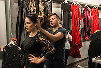 NWA Democrat-Gazette/ANTHONY REYES &bull; @NWATONYR<br /> Raul Rulli Torres, of Dallas, adjusts the hair and outfit of Grisell Naranjo Montoya of Guanajuato, Mexico Friday, Nov. 6, 2015 before a fashion show at the Springdale Civic Center. Northwest Arkansas Community College is sponsoring the show. It will feature designs from Gatsby's Boutique of Fayetteville, Cinderella's Boutique of Rogers and designs from Raul Rulli Torres, a NWACC graduate. Torres has shown in New York and was featured in Latino Fashion Week 2014 Dallas. All proceeds from the show benefit the college's scholarship fund. Montoya always models in shows for Torres.