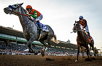 ARCADIA, CA - DECEMBER 26: Unique Bella # 3 with Mike Smith up holds of Paradise Woods #7 and Flavien Prat to win the La Brea Stakesat Santa Anita Park on December 26, 2017 in Arcadia, California. (Photo by Alex Evers/Eclipse Sportswire/Getty Images)