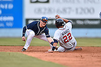 Asheville Tourists second baseman Forrest Wall (7) puts the tag on Wigberto Nevarez (22) during a game against the Rome Braves on May 16, 2015 in Asheville, North Carolina. The Braves defeated the Tourists 6-3. (Tony Farlow/Four Seam Images)